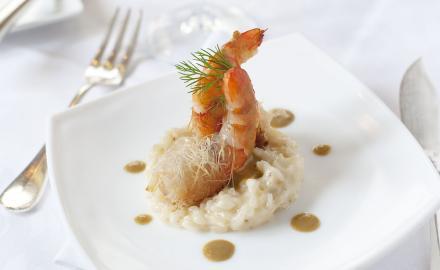 Risotto acidulé, crevettes croustillantes et crème d'étrilles